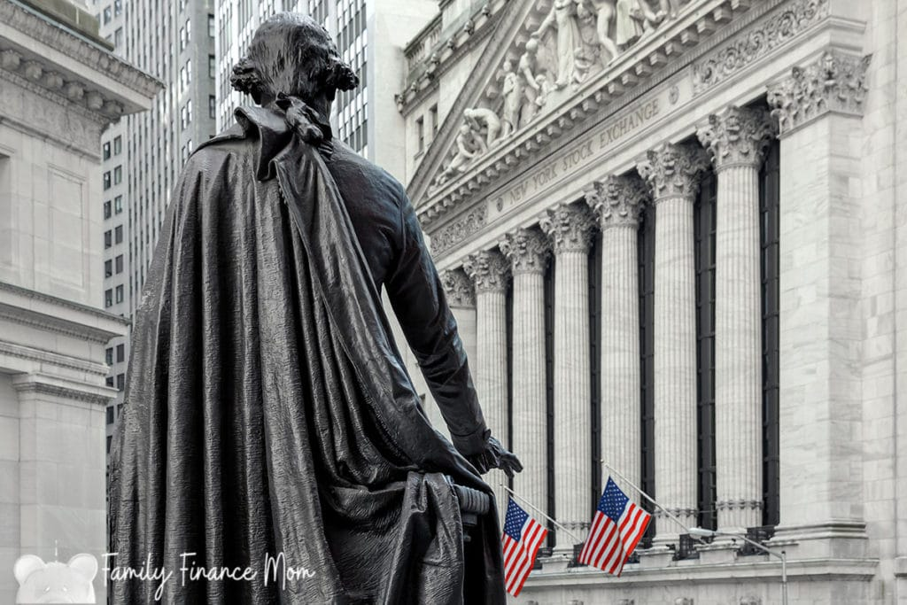 Wall Street with New York Stock Exchange in Manhattan Finance district and Washington statue in the foreground