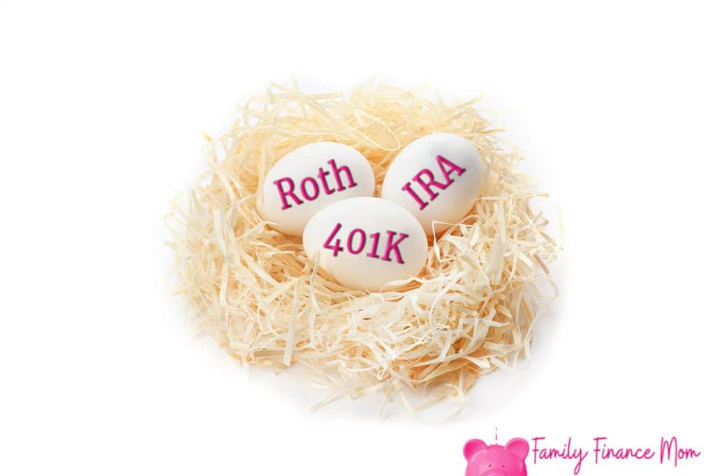Eggs with words PENSION, RETIRE and 401k in nest on white background